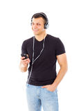 Man listening radio show over phone with headphones Royalty Free Stock Images