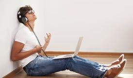 Man listening rock music Royalty Free Stock Image