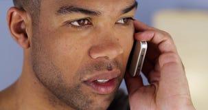 Man listening on smartphone Royalty Free Stock Photo