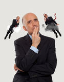 Man listening to an angel and a devil. Giving advise Royalty Free Stock Images