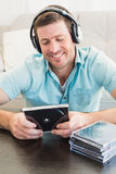 A man listening to cds Stock Photos