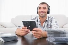 A man listening to cds Royalty Free Stock Photo