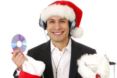 Man listening to Christmas Music Stock Images
