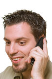 Man listening to good news on the phone Stock Images