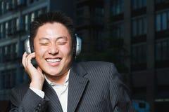 Man listening to headphones Royalty Free Stock Photos