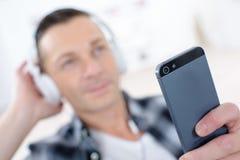 Man listening to cellular phone Stock Photo