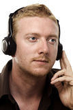 Man Listening to his Headphones Royalty Free Stock Images