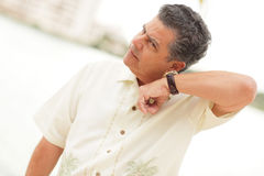 Man listening to his watch Royalty Free Stock Images