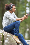 Man Listening To MP3 Player Whilst Hiking Royalty Free Stock Images