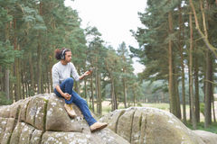 Man Listening To MP3 Player Whilst Hiking Royalty Free Stock Photos