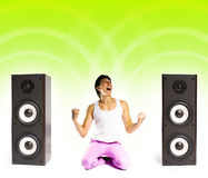Man listening to music. A young man listening to modern music stock images