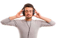 Man listening to music. Happy young man with headphones on and listening to music Stock Photos