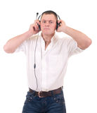 Man listening to music on headphone. Young man listening to music on headphone Stock Photography