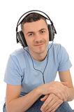 Man listening to music in headphones on computer Stock Image