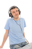 Man listening to music in headphones from computer Stock Image