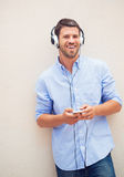 Man listening to music with headphones Stock Images