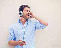 Man listening to music with headphones Stock Photography