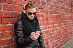 Man listening to music on headphones from his smartphone Royalty Free Stock Photography