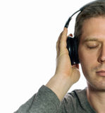 Man listening to the music in headphones. Stock Images