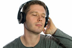 Man listening to the music in headphones. Stock Image