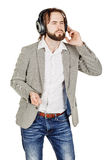 Man listening to music on headphones, studio shot isolated on th Stock Image