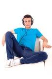 Man listening to music on his headphones Stock Image