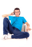 Man listening to music on his headphones Royalty Free Stock Photo