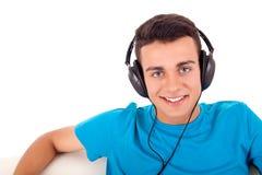 Man listening to music on his headphones Stock Photos