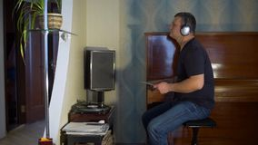Man listening to music on the vynyl turntable stock video footage