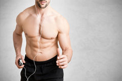 Man Listening to Music and Jogging Stock Photography