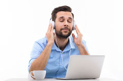 Man listening to music on laptop Royalty Free Stock Image