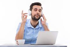 Man listening to music on laptop Stock Photos