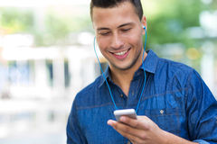 Man listening to music on mobile phone Stock Image