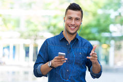 Man listening to music on mobile phone Royalty Free Stock Image