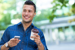 Man listening to music on mobile phone Royalty Free Stock Images