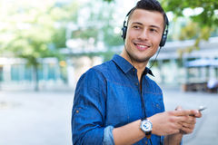 Man listening to music on mobile phone Stock Photography