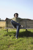Man Listening To Music On Park Bench Stock Images
