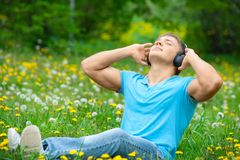 Man listening to music outdoors Stock Photography