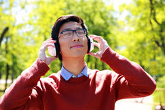 Man listening to music in the park Royalty Free Stock Image