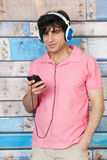 Man listening to music with smart phone Royalty Free Stock Photo