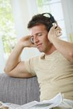 Man listening to music smiling Royalty Free Stock Photo