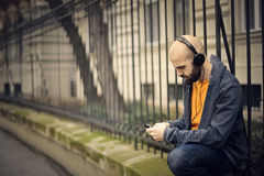 Man listening to music Stock Photo