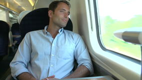 Man Listening To Music On Train Journey Royalty Free Stock Photos