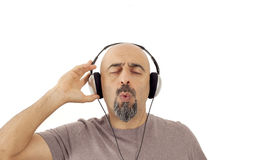 The man listening to the music and whistling Stock Photo