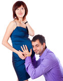 Man is listening to a pregnant wife's belly Stock Images