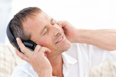Man listening to some music. At home Stock Photo