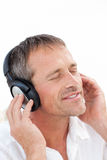 Man listening to some music. At home Stock Images
