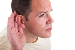 Man, listening, viewing the  gesture of hand behin Stock Image
