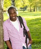 Man listens music in a park Royalty Free Stock Image