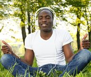 Man listens music in a park Stock Photography